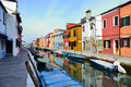 Canal dividing unique all colored houses burano Stock Photography