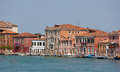 Canal and facades in murano veneto italy houses an island near venice the Stock Photos