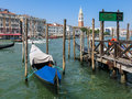 Canal grande waterfront venice gondola service across in the background the campanile san marco of fondamenta salute dorsoduro in Stock Photo