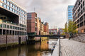 Canal Lined with Modern Brick Buildings and Cobbled Footpath Royalty Free Stock Photo