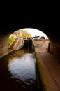 Canal lock gate d tilt and shift photograph of a on a taken from a tunnel Stock Photo