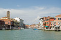 Canal through murano venice view from the middle of a running the island of Stock Image
