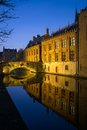 Canal at night in bruges belgium houses along Stock Photography