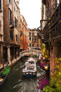Canal outside the trattoria sempione venice italy lovely flowers and lanterns make an inviting presentation at popular restaurant Stock Images
