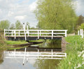 Canal swing bridge fordgate located on the bridgwater and taunton in somerset peaceful slow moving water that gently brakes up the Royalty Free Stock Image