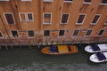Canal in venice looking down on a italy with boats Royalty Free Stock Photo
