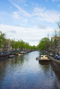 Canals of amsterdam holland old houses on canal ring Royalty Free Stock Images