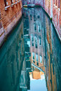 Canals of venice with reflection in water italy Stock Images