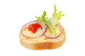 Canape brie cheese red onion tomato and lettuce on french bread isolated against white Stock Image