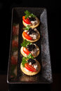 Canape made from biscuit tuna pate tomato pasley and caviar Royalty Free Stock Photos