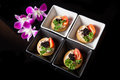 Canape made from biscuit tuna pate tomato pasley and caviar Stock Images