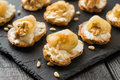 Canape with ricotta cheese, pears, nuts and honey Royalty Free Stock Photo