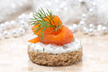 Canape with rye bread cream cheese salmon and dill greens for the holiday close up horizontal Royalty Free Stock Photo