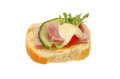 Canape slice of french bread with ham tomato lettuce cucumber and salad cream isolated against white Royalty Free Stock Photo