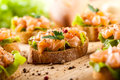 Canape with smoked salmon on wooden table Stock Photography