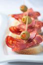 Canapes with chorizo Stock Photo