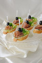 Canapes with ham mini sandwiches and cucumber on a baguette Stock Image