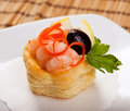 Canapes with   prawns  and lemon Stock Images