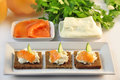 Canapes rye bread with ricotta cheese and smoked salmon Stock Image