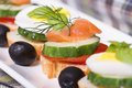 Canapes with salmon cucumber tomato and dill closeup horizontal Stock Images