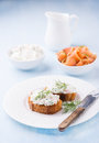 Canapes with soft cheese spread on white plate Royalty Free Stock Photo