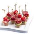 Canapes tomato bacon plate Royalty Free Stock Photo