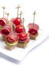 Canapes tomato bacon plate Royalty Free Stock Photos