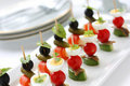 Canapes on toothpicks ,  pinchos Royalty Free Stock Photography