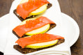 Canapes with wild salmon and caviar apple slice Stock Image