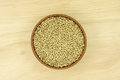 Canary seed in a wooden bowl Royalty Free Stock Photo