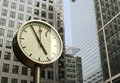 Canary wharf east london clock in front a modern buildings in Royalty Free Stock Photo