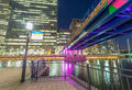 Canary Wharf skyline from street level at night, London UK Royalty Free Stock Photo
