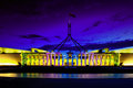 Canberra enlighten festival new parliament hou house film projection on walls with reflection in pool Royalty Free Stock Images