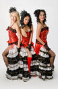 Cancan dancers three young girls dancing in studio a french Stock Photography
