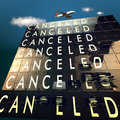 Cancelled on a mechanical timetable sky and plane Stock Photos