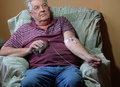 Cancer patient chemotherapy via picc line at home a senior man who has self medicating with a is inserted into his vein through Royalty Free Stock Photos