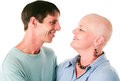 Cancer patient and husband in love smiles at her loving supportive white background Stock Image