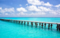 Cancun pier empty over beautiful blue water mexico Stock Images