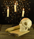 Candelabra with skull and letter candelanra human shabby on black shining background Stock Photos