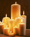 Candes group of burning candles at a dark background Royalty Free Stock Photos