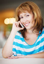 Candid image young woman talking phone cafe selective focus Stock Image