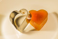 Candied fruit jelly apricot in the form of heart with iron form Royalty Free Stock Photo
