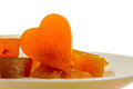 Candied fruit jelly apricot in the form of heart on isolated background Royalty Free Stock Photo