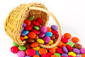 Candies in a basket colorful sugar coated chocolate Royalty Free Stock Images