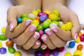 Candies in hands Royalty Free Stock Images
