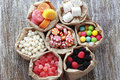 Candies many assorted sweet sugar on vintage wooden background top view point Stock Photography