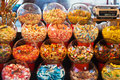 Candies at a market stall with bowls of different and weight scale Royalty Free Stock Images