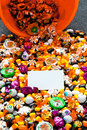 Candies spilling out of the basket with placard on it Royalty Free Stock Photos