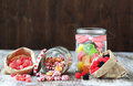 Candies sweet sugar in glass jars on brown vintage wooden background Stock Photos