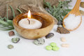 Candle and bath salt with vitamin pills a bowl of olive wood Royalty Free Stock Image